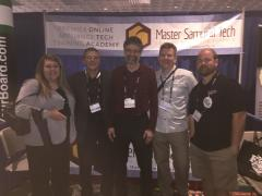 Friends in front of the Master Samurai Tech booth at the ASTI trade show
